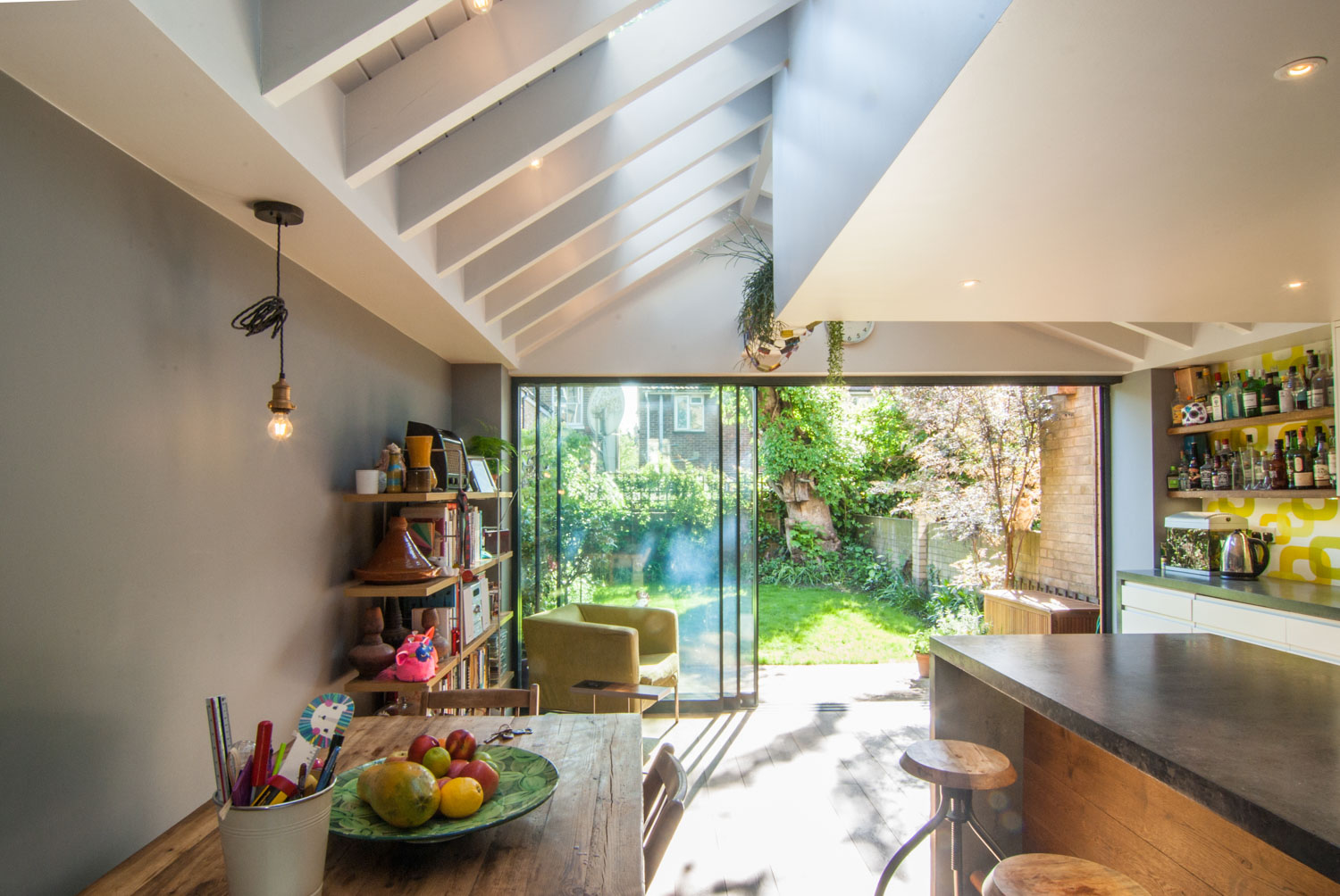 Exposed timber joists with roof light above make this kitchen dining area an enjoyable space.
