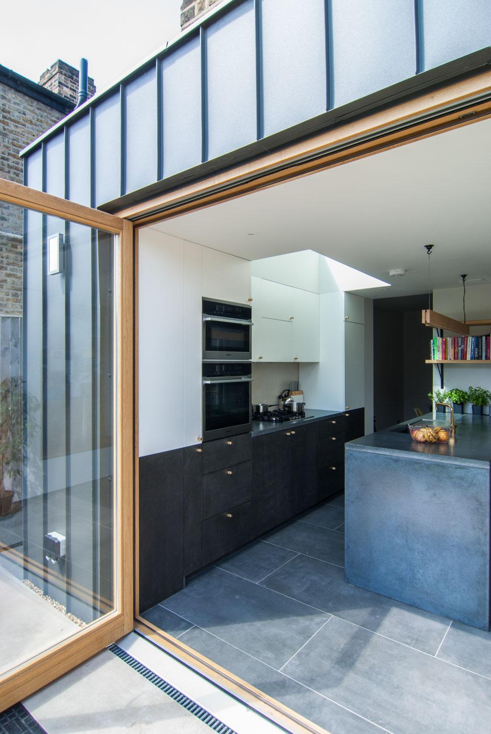 standing seam zinc cladding black concreto strata tile mortise concrete worktop MDF Bespoke oak bi-fold door