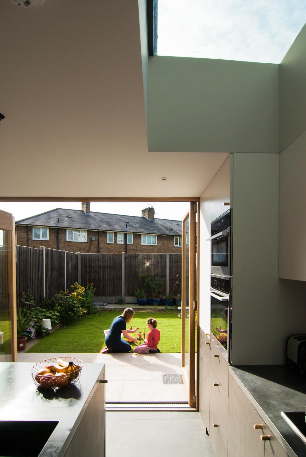 Bespoke oak bi-fold door patio black mdf concreto strata tile Buster+punch handles