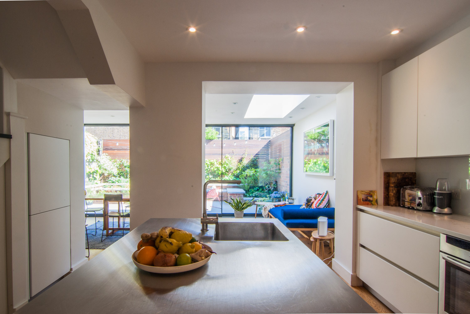 Stainless steel worktop on kitchen island are the centre piece of the ground floor extension.