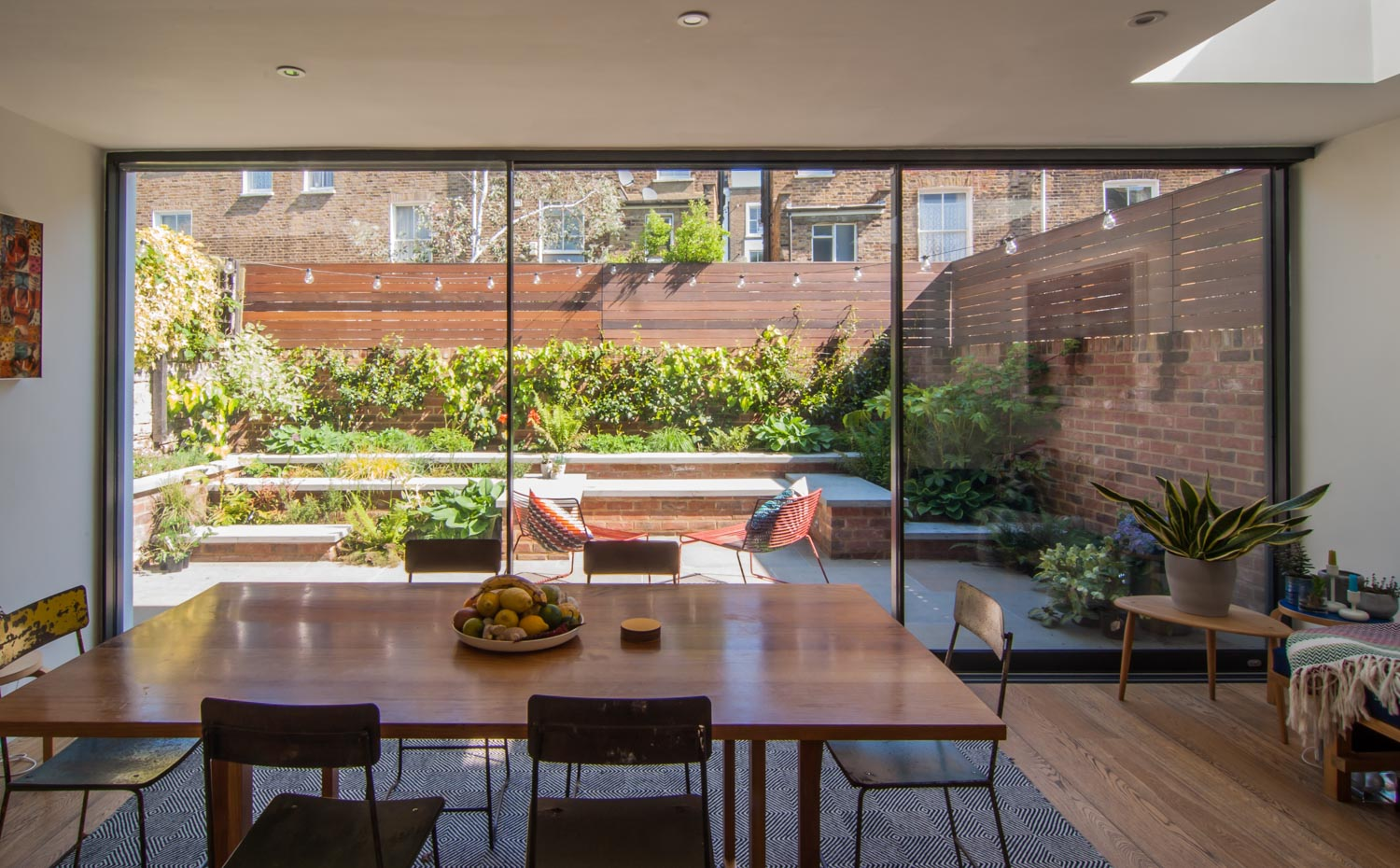 Sun filled garden patio as a beautiful backdrop of the dining area.