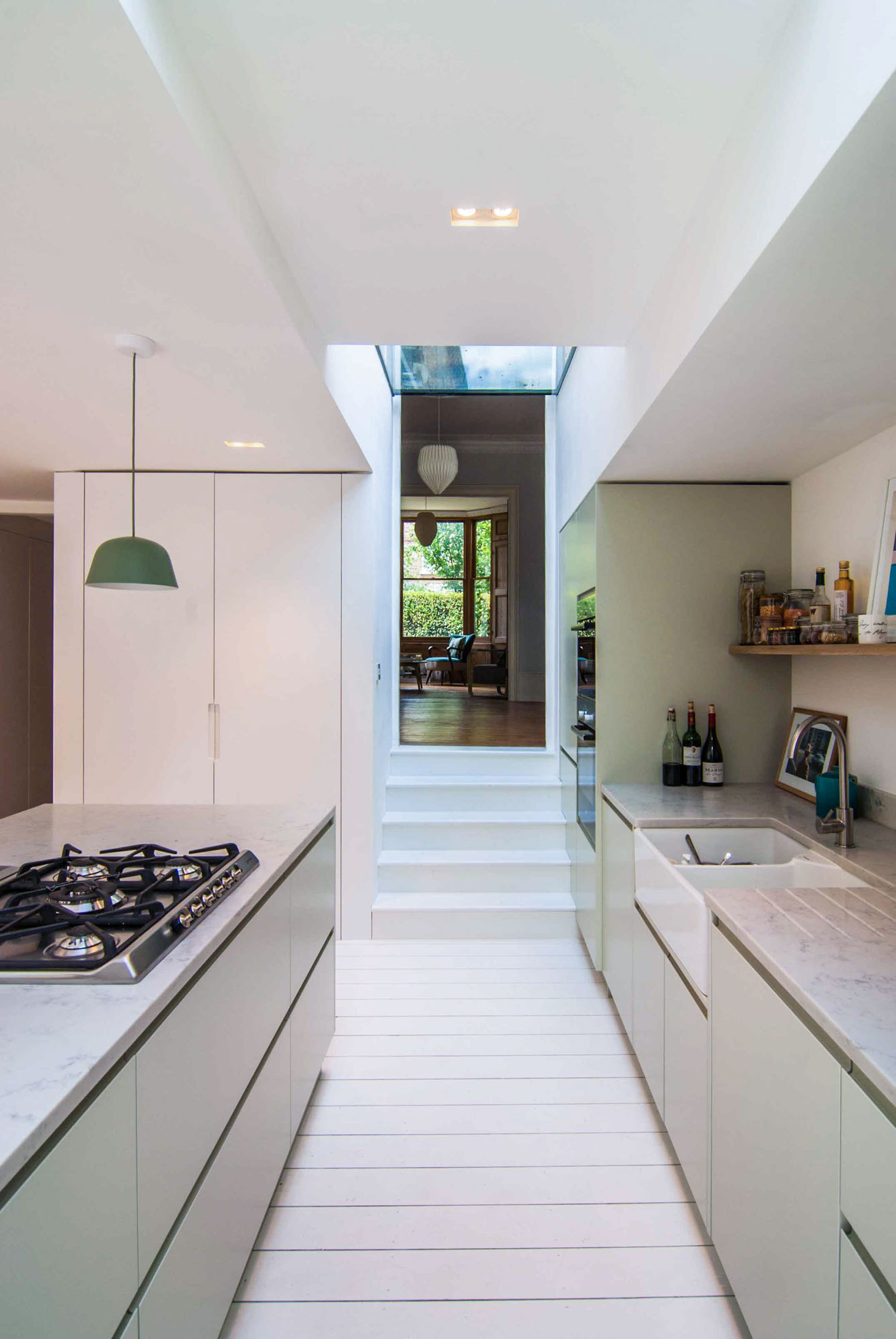 Photographer's House: Contemporary spacious kitchen with a minimalist colour palette.