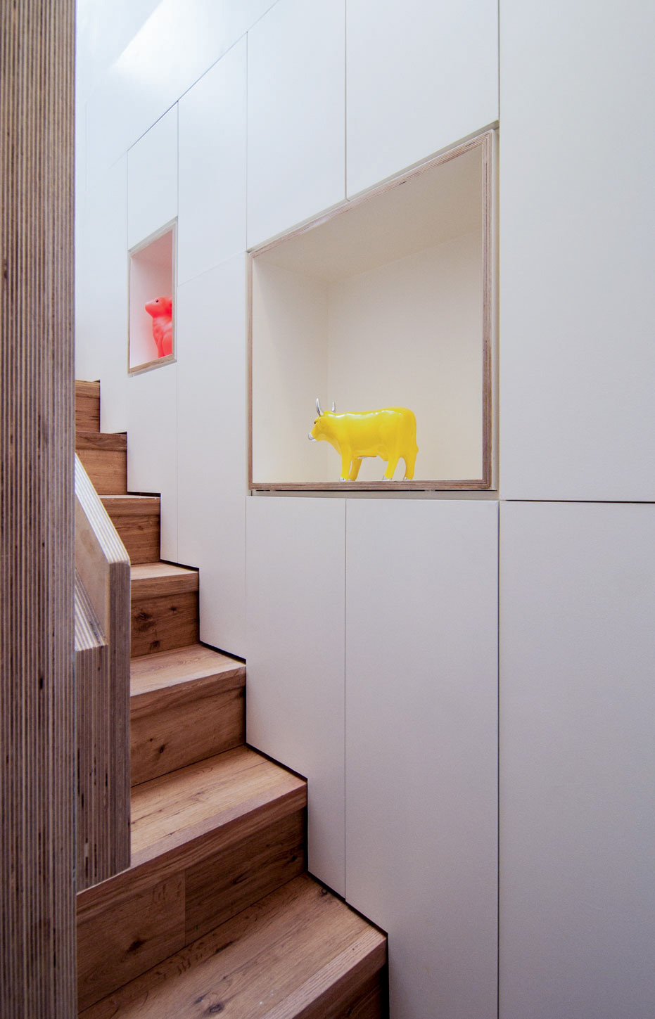 Bespoke staircase and contemporary storage and shelving providing plenty of storage space.