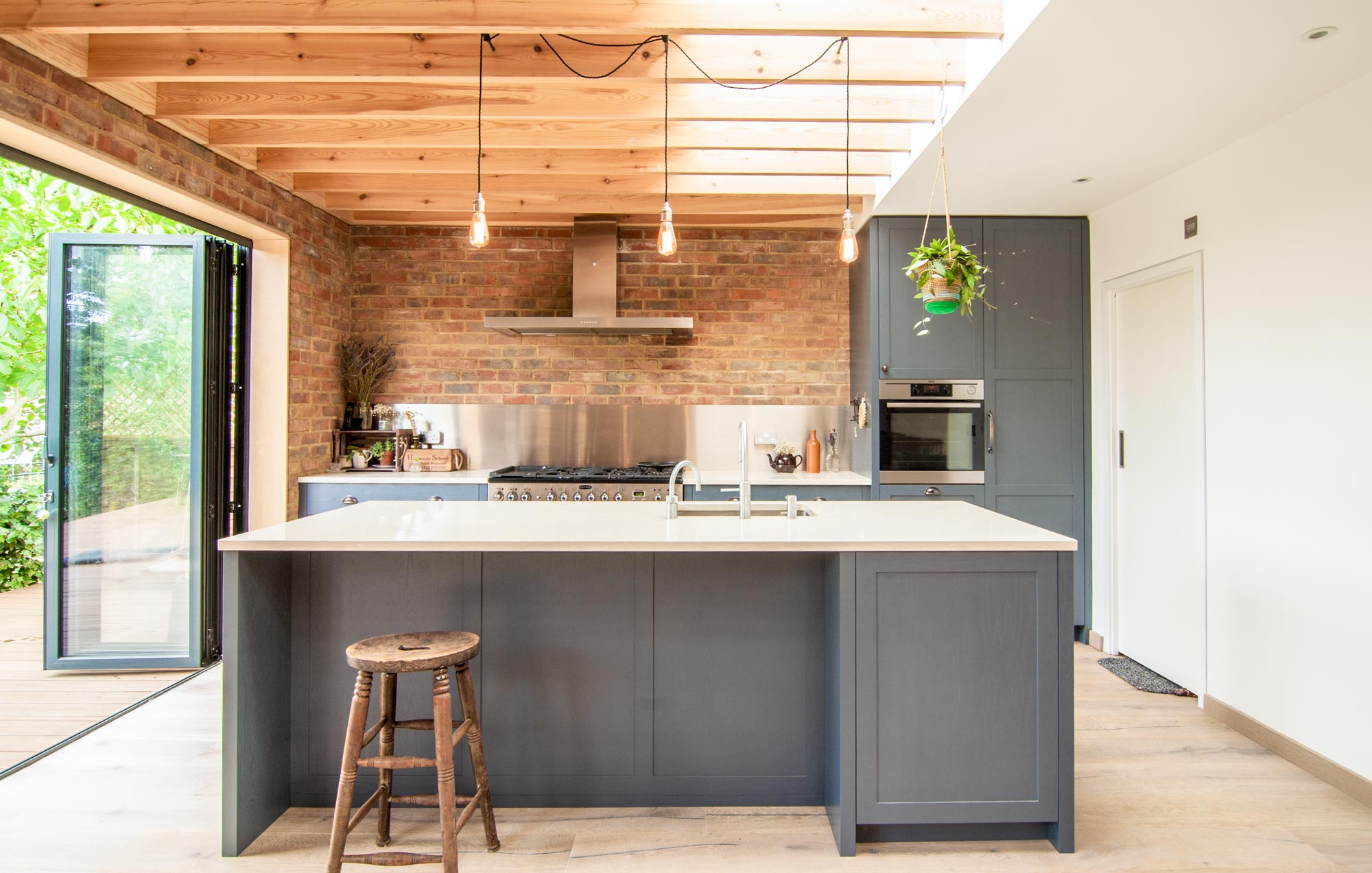 Exposed brick walls and timber beams in the new kitchen extension.