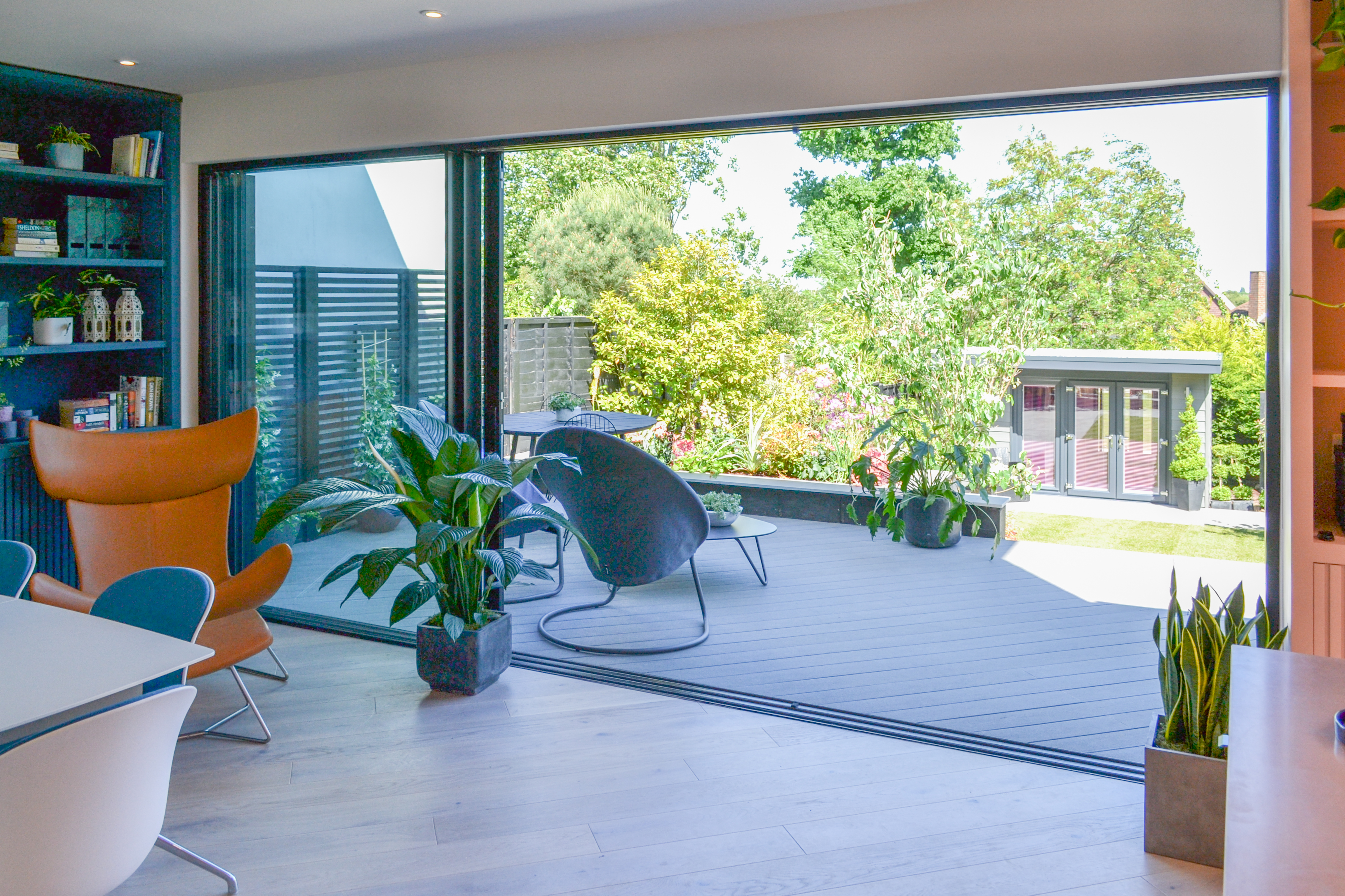 Perspective view of the large sliding doors and spacious rear patio.