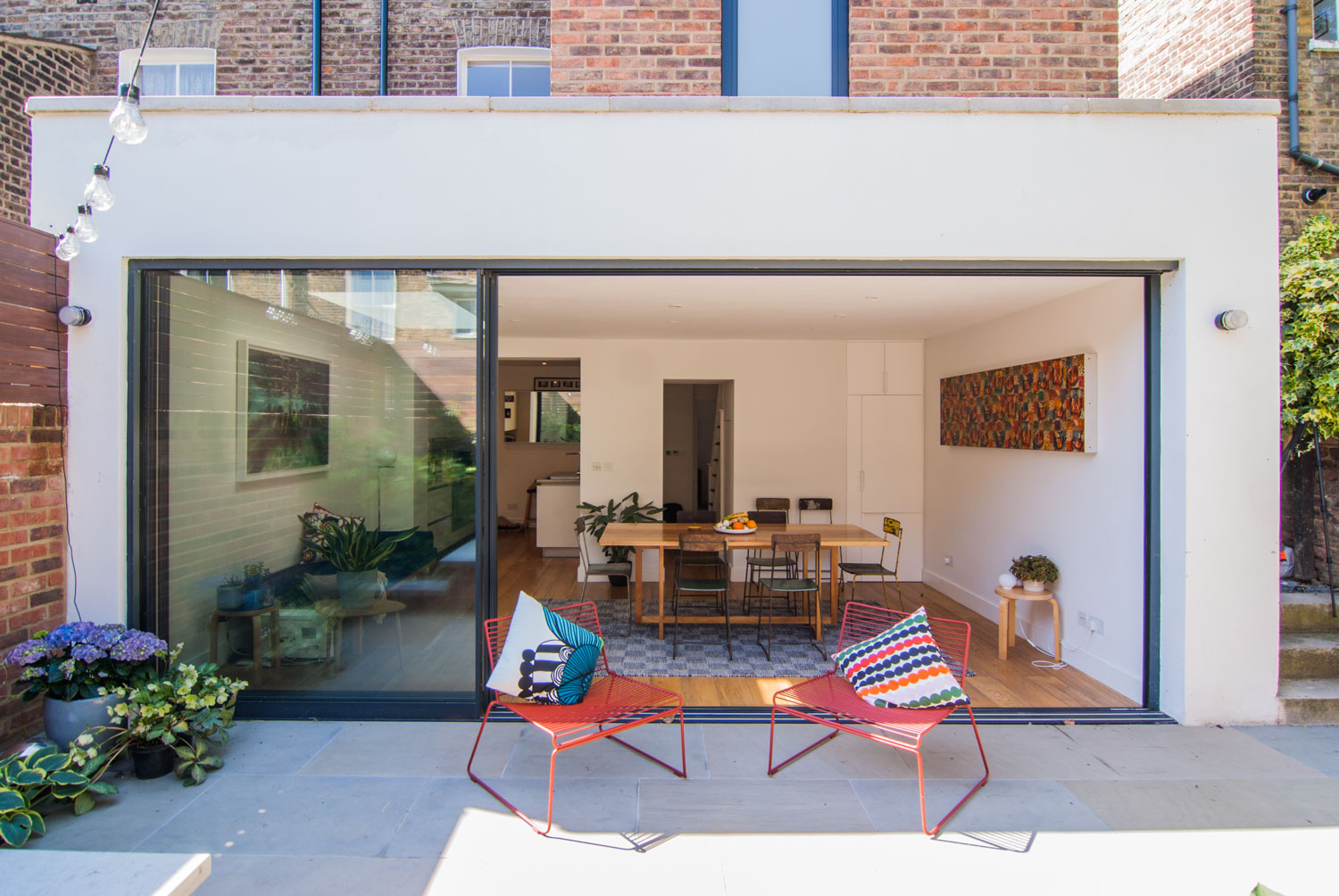 Rear extension including large sliding doors leading to an open and spacious dining area.