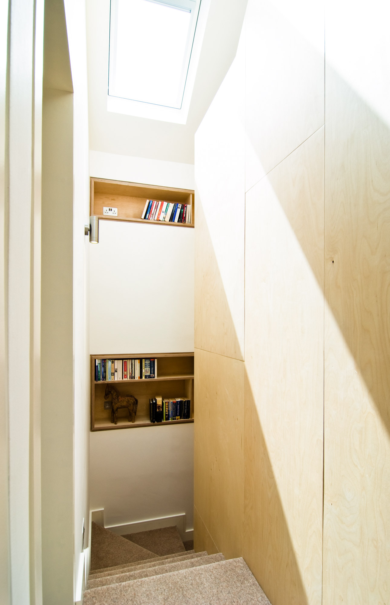 Close up of the plywood shelving by the staircase.