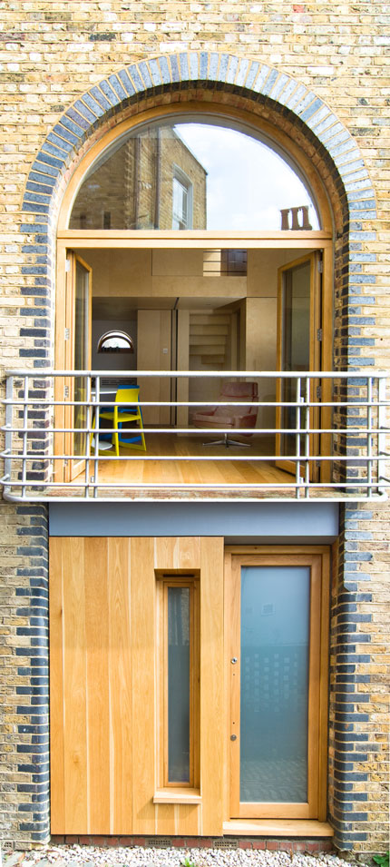 Arched balcony doors overlooking the entrance to the Mews property.