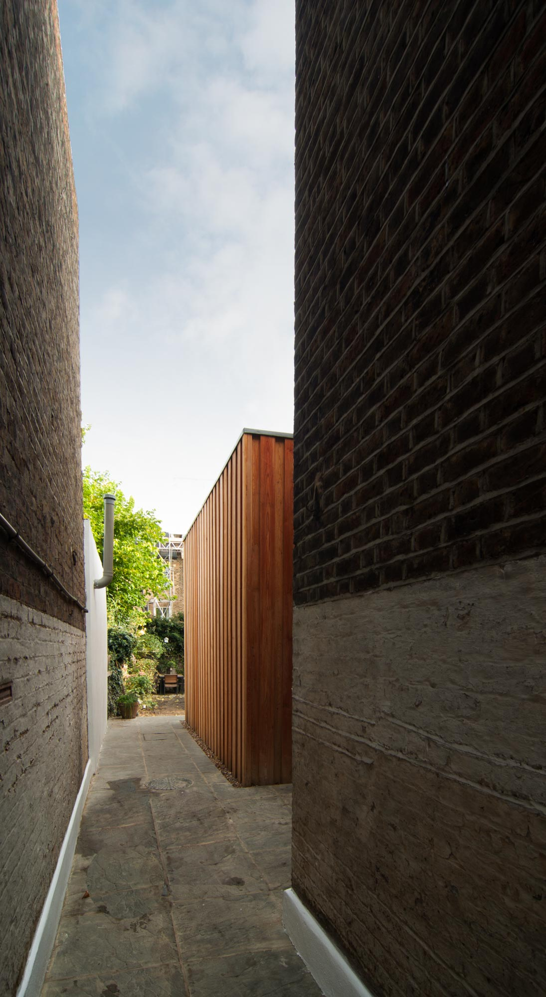 Brick wall and timber exterior of the rear extension in Stoke Newington.