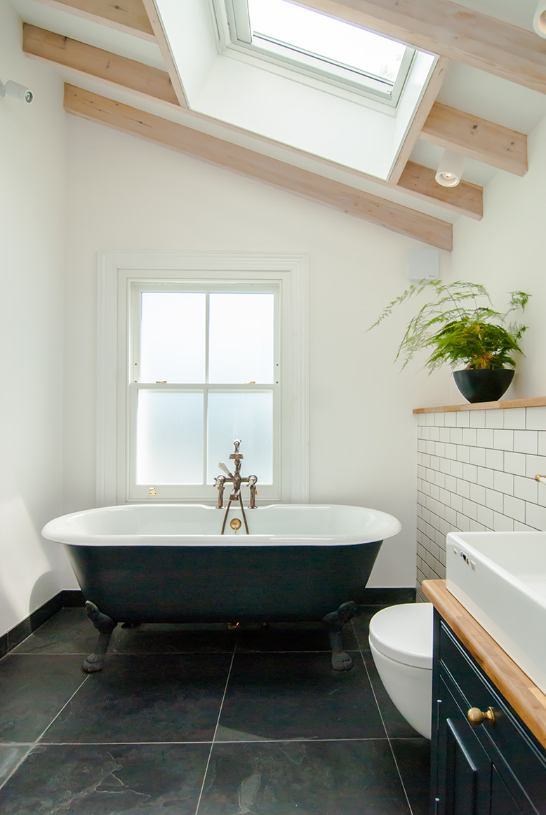 The beautiful bathtub on legs being another key feature in this renovated bathroom.