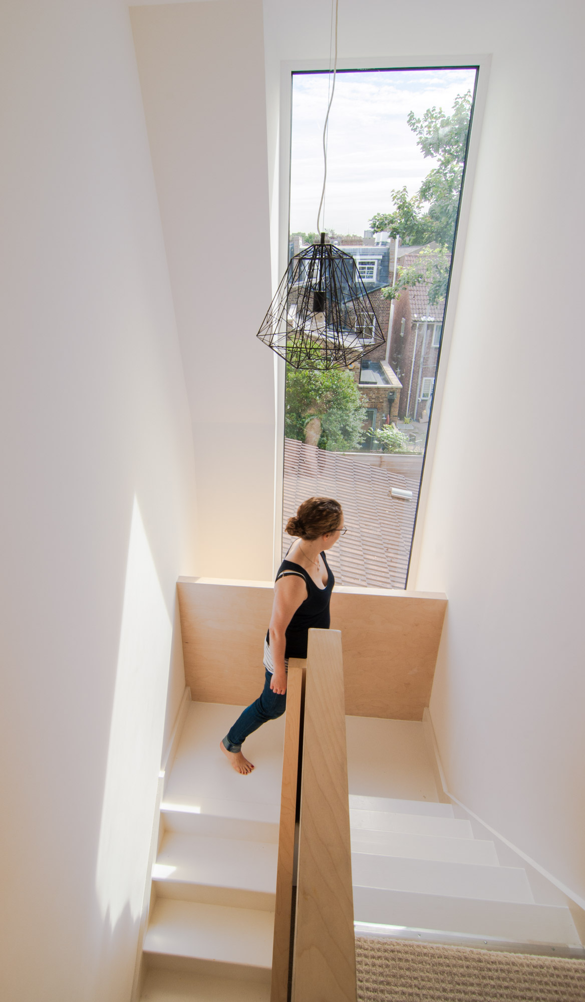 Plywood balustrade stands out amongst a rather minimal colour palette of the renovated staircase.