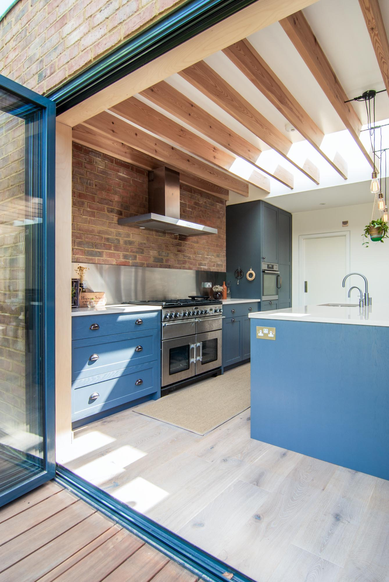 Close up of the large blue doors and a perspective view of the kitchen.
