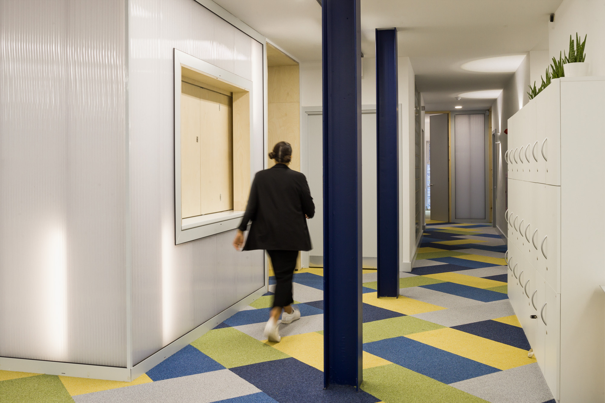Tile imitation carpets and coloured columns in the charity office.