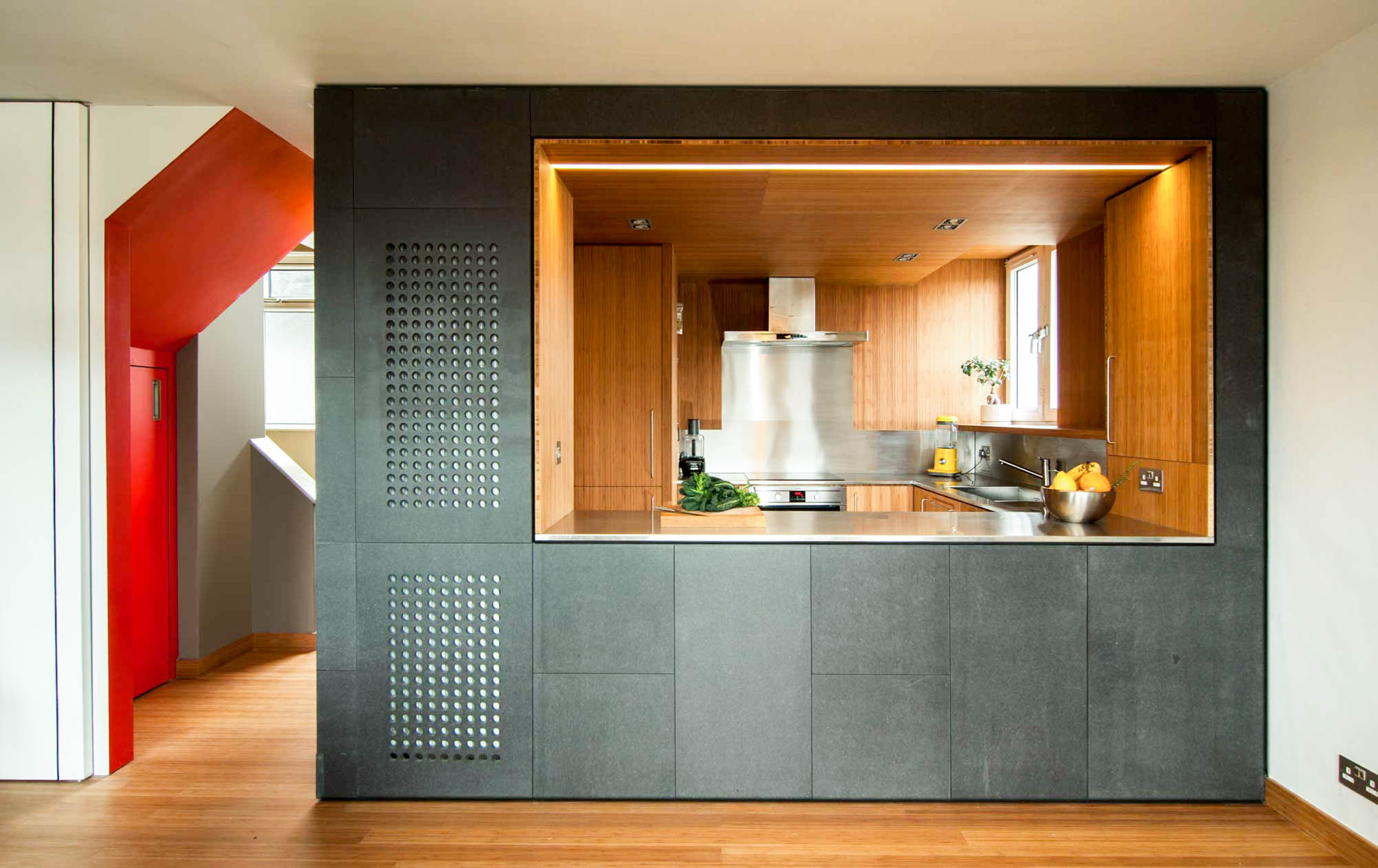 A kitchen pod consisting of contrasting materials and colours.