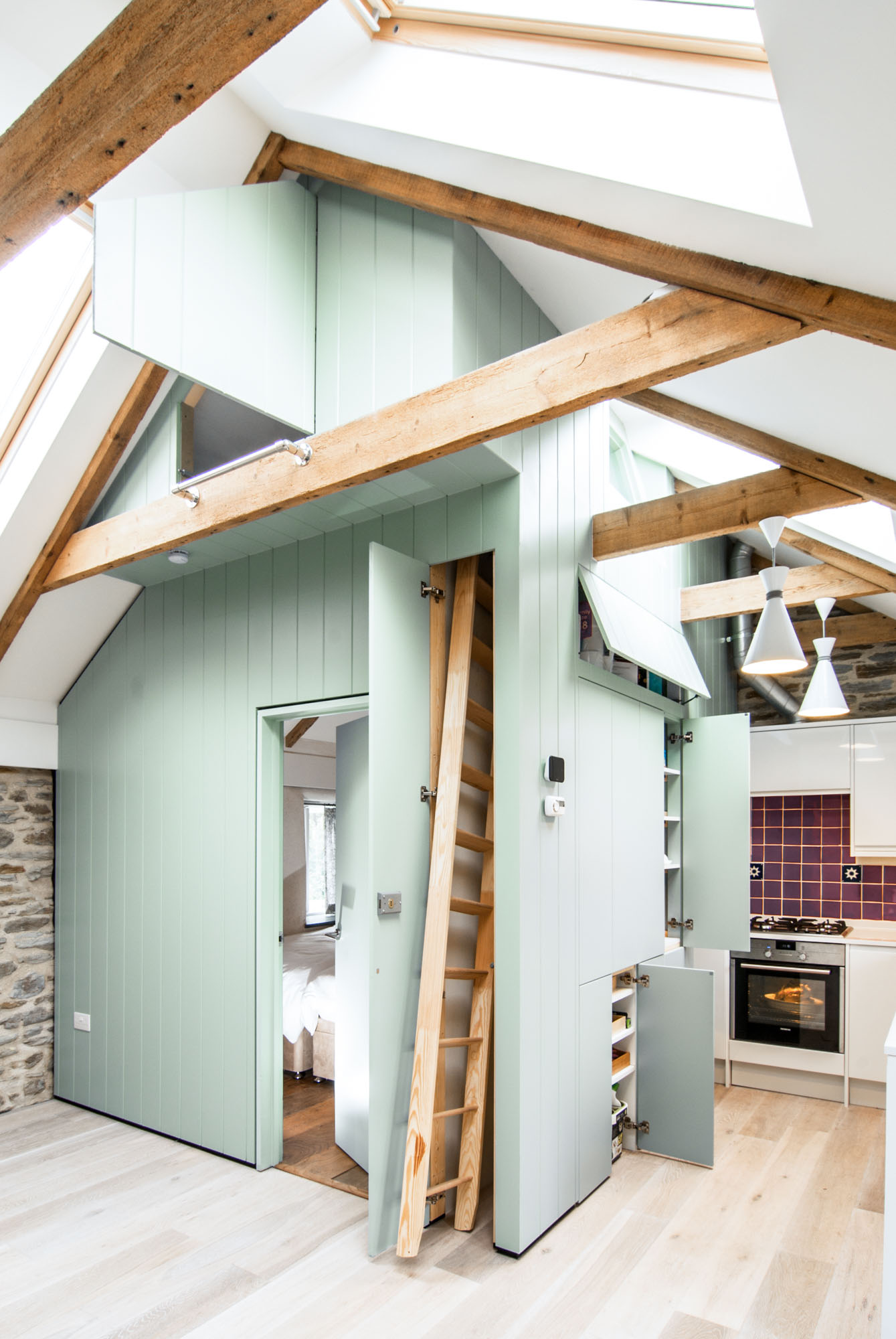 Exposed beams and hidden ladder within the concealed room structure.