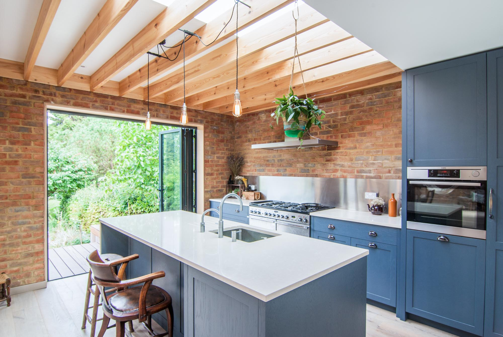 Blue kitchen cabinets stand out amongst the muted colours of the rest of the kitchen.