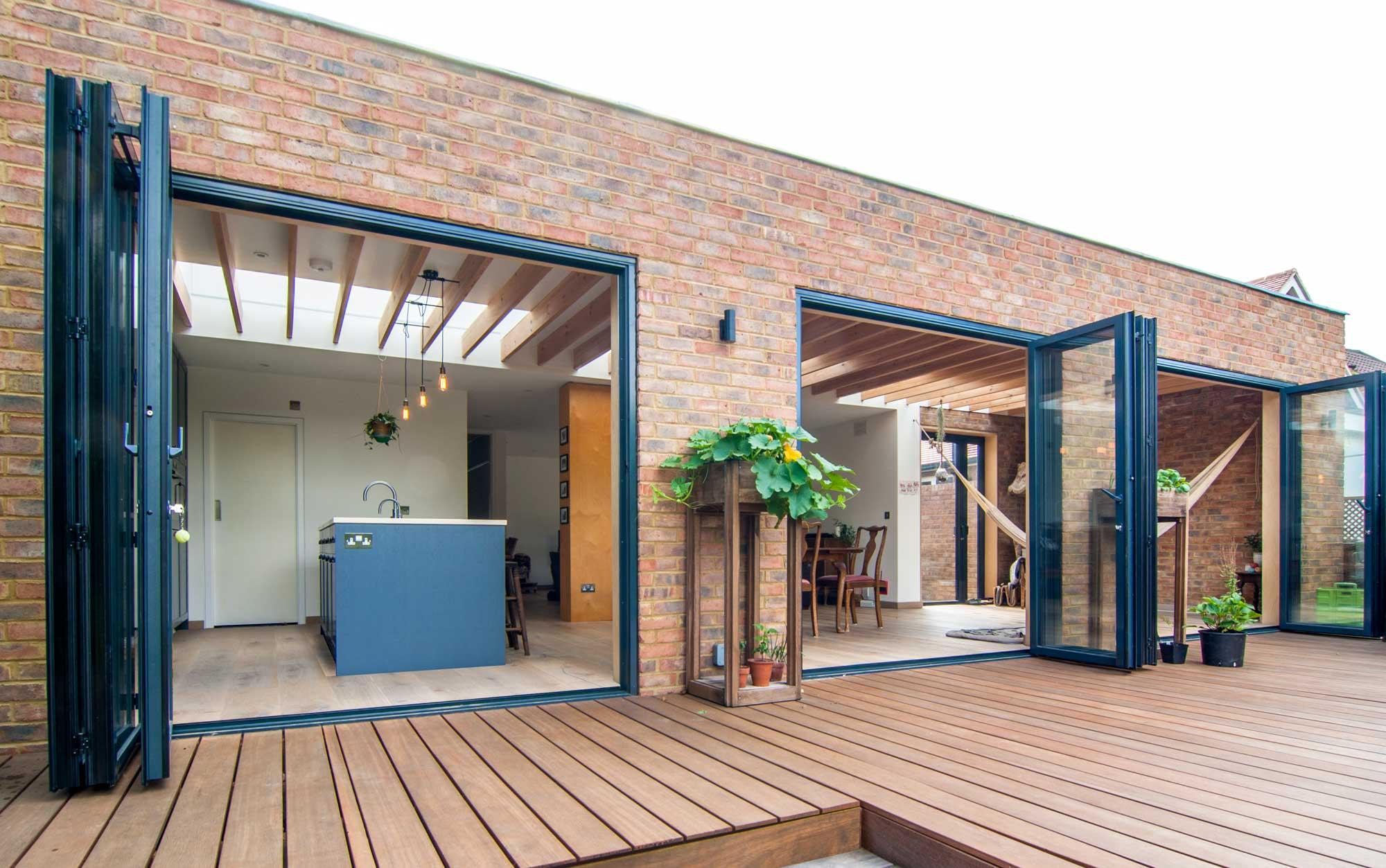 Three blue bi-fold doors and brick facade of the rear extension.