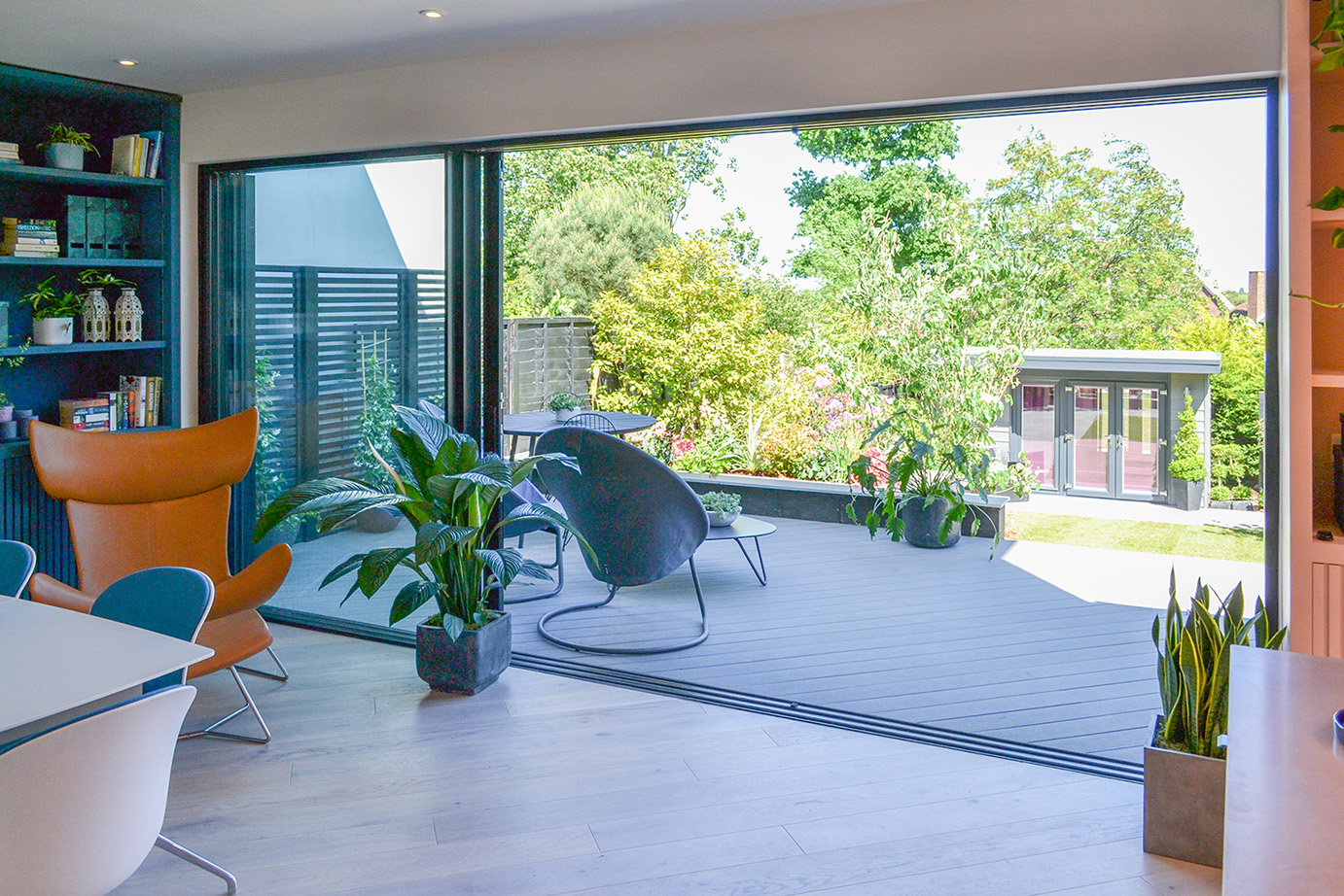 Love Your Home and Garden- Perspective view of the large sliding doors and spacious rear patio.