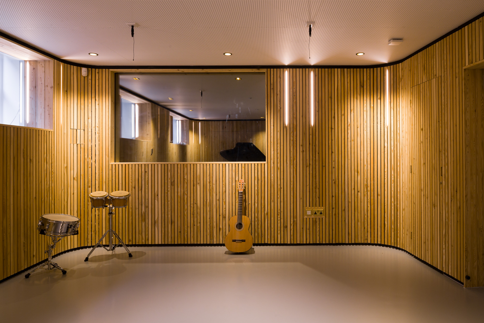 Music room walls layered with timber battens.