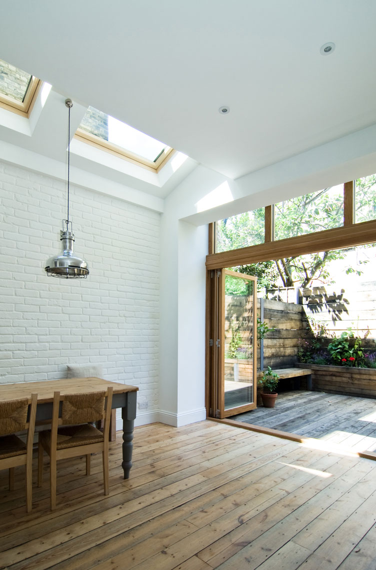Large oak doors and rustic floorboards in the rear extension of the London Terrace House.