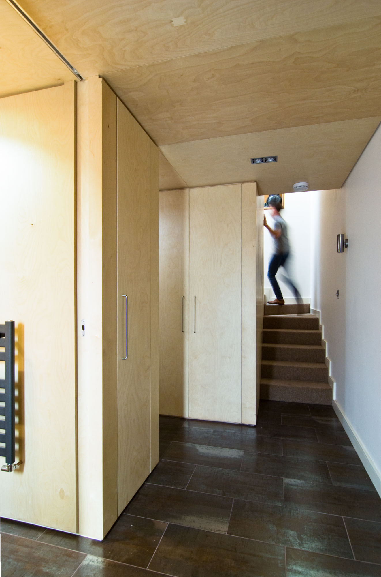 Plywood ceiling and storage within the Mews property.