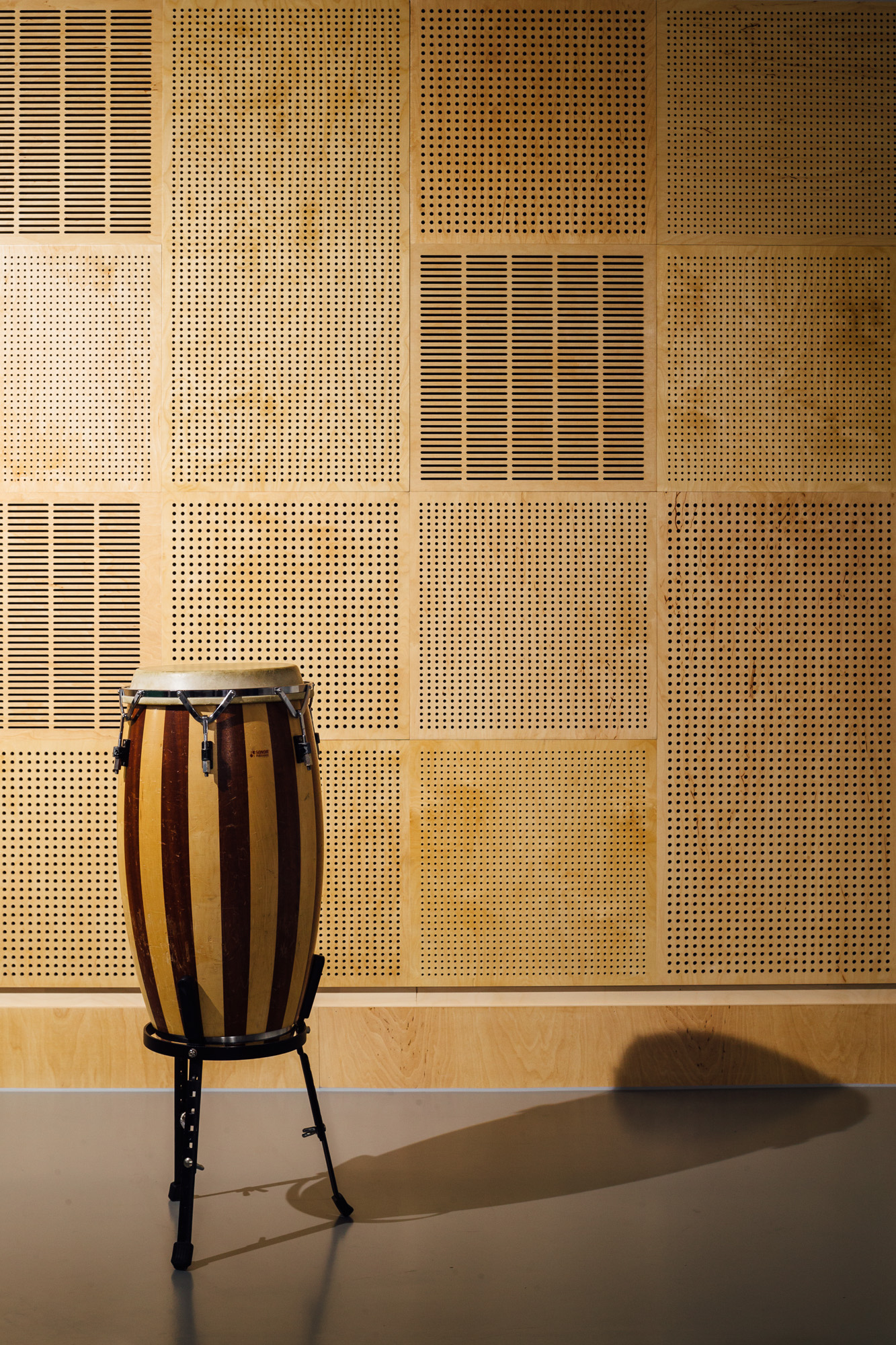Plywood panels perform well with the acoustics necessary for the refurbished music room.