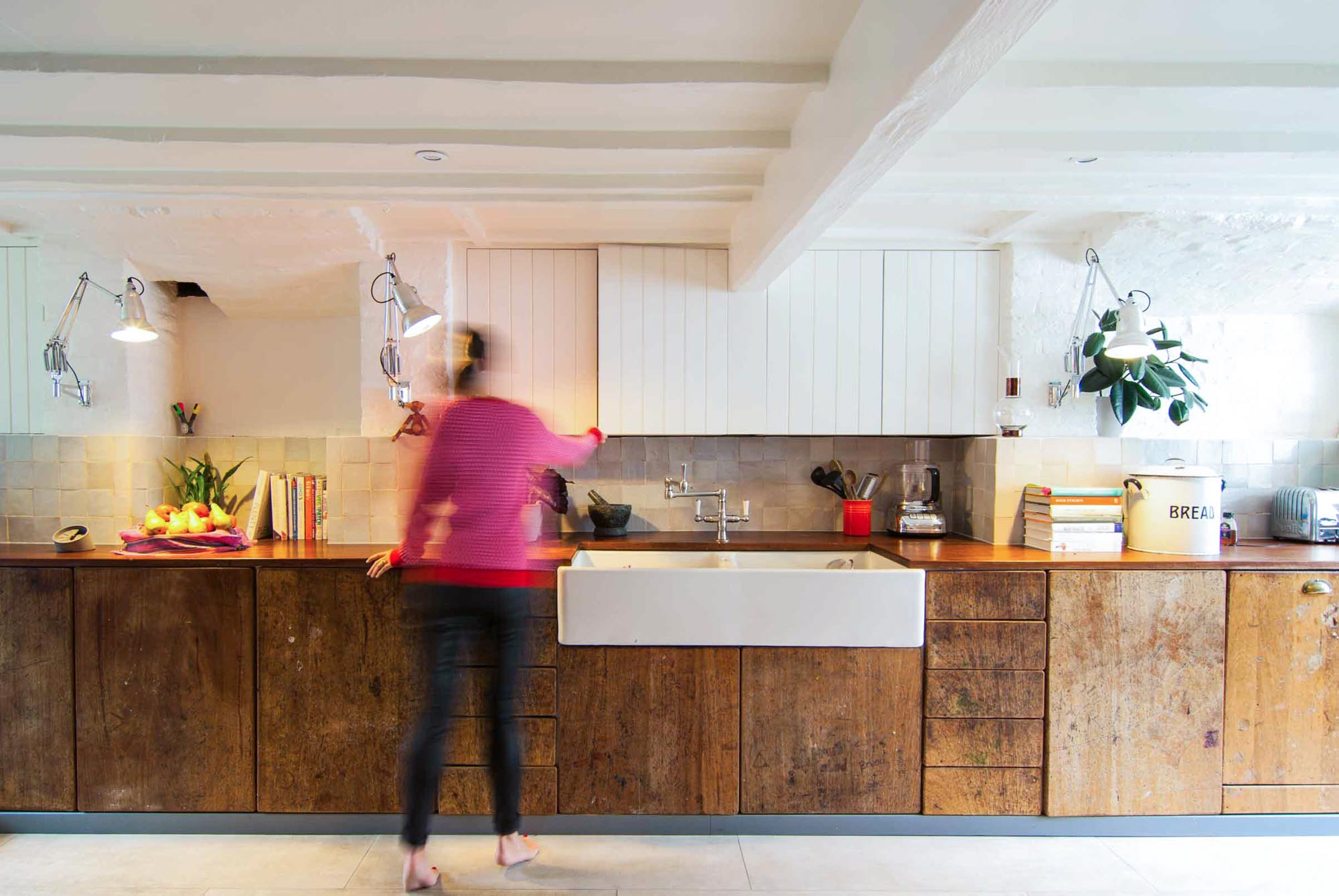 Barrel House - White colour palette brings focus to the timber kitchen cabinets.