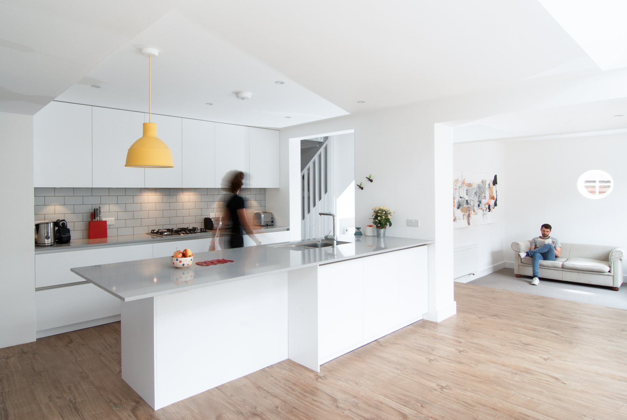 Perspective view of the renovated kitchen with a very minimal colour palette.