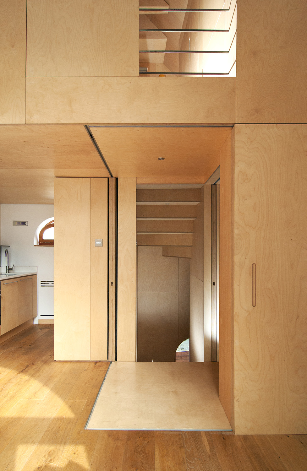 Entrance to the Plywood corridor from the open plan kitchen and living space.