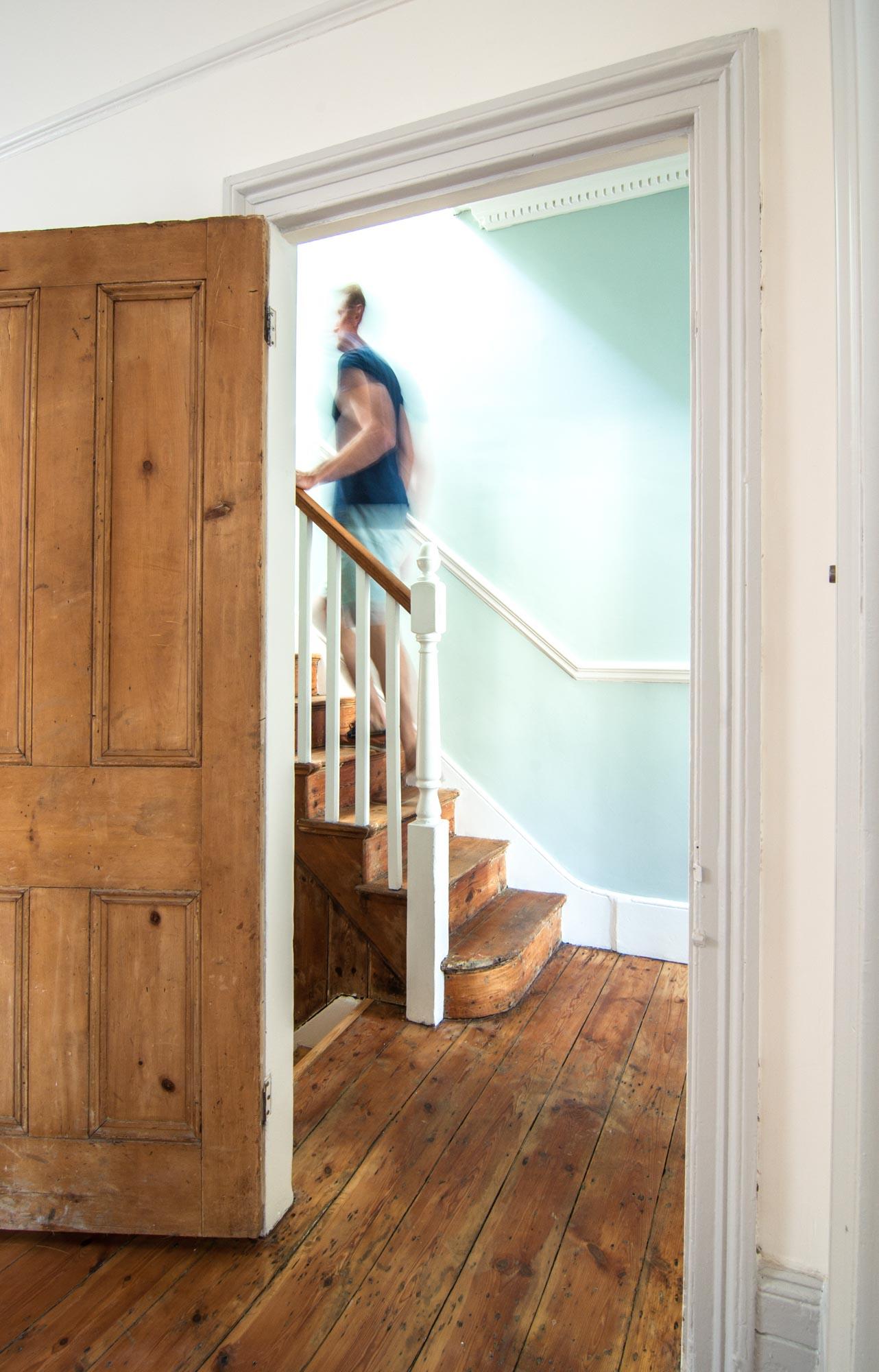 Rustic floors and door in a Victorian terraced house in Stoke Newington.