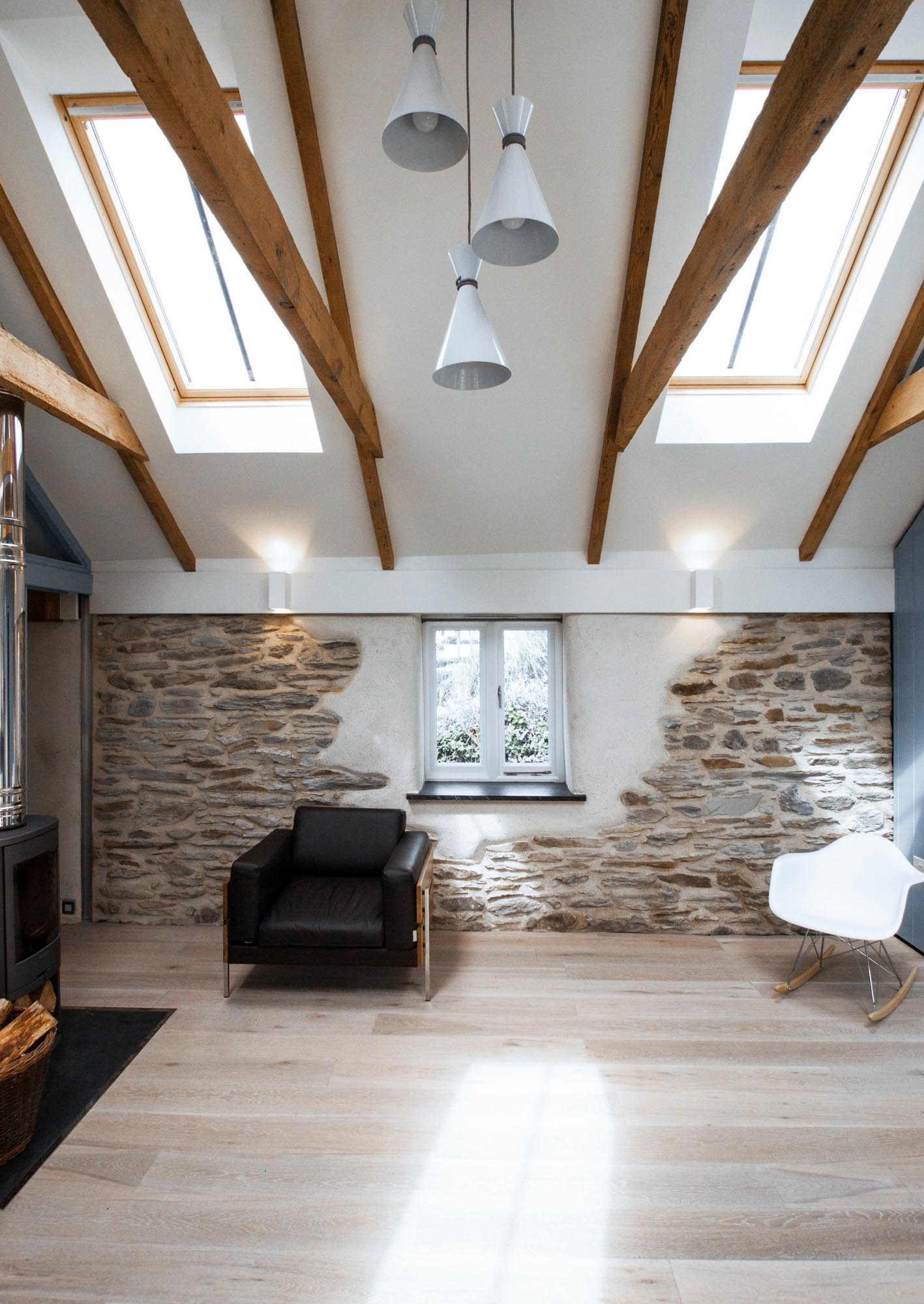 Exposed stone and original timber beams in the beautiful cottage.